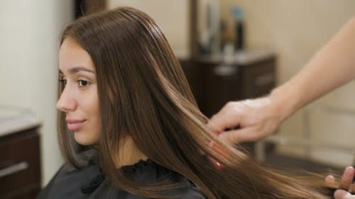 Combing Woman's Hair
