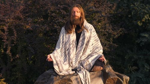 Man Meditating on Nature