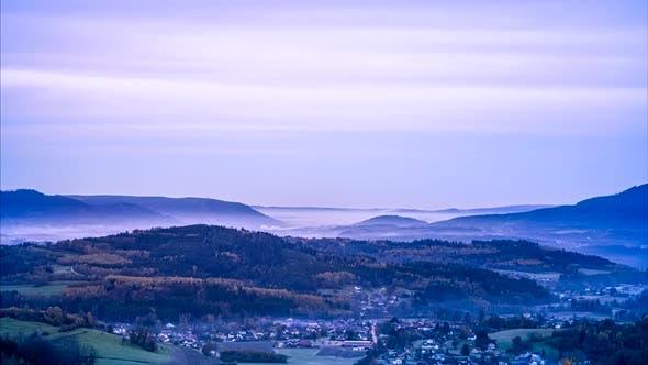 Thumbnail for Morning fog above village, France.