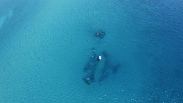 Aerial view of a ship wreck in the ocean