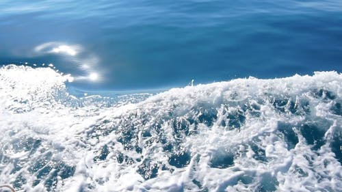 Beautiful Deep Blue Mediterranean Sea Water. Ocean Waves. Cruise Ship Vacation in Europe