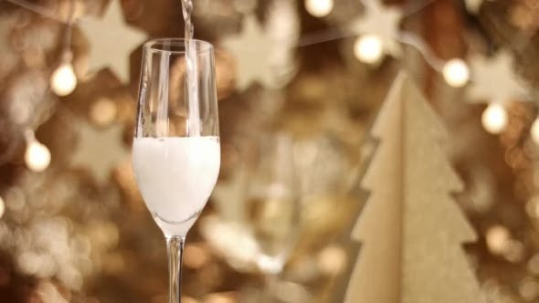 Thumbnail for Champagne Poured Into a Glass with Christmas Decorations