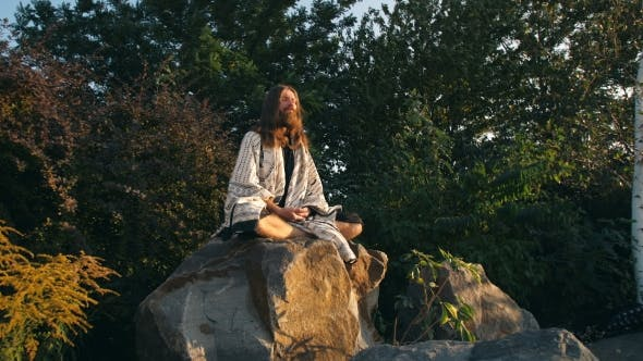 Thumbnail for Yogi Sitting on the Rock and Meditating