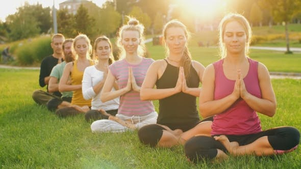 Thumbnail for Group of People Meditating at Sunset