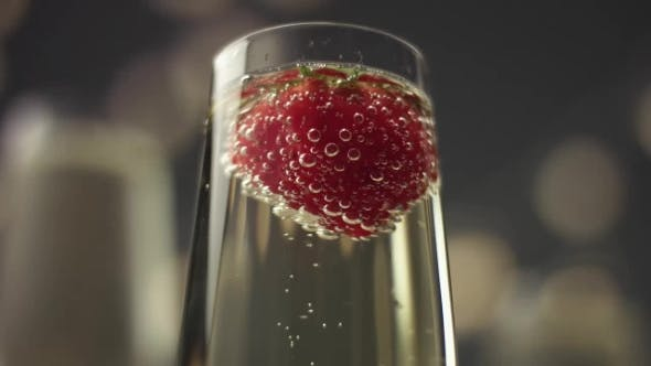 Thumbnail for Glass of Champagne with a Strawberry Floating