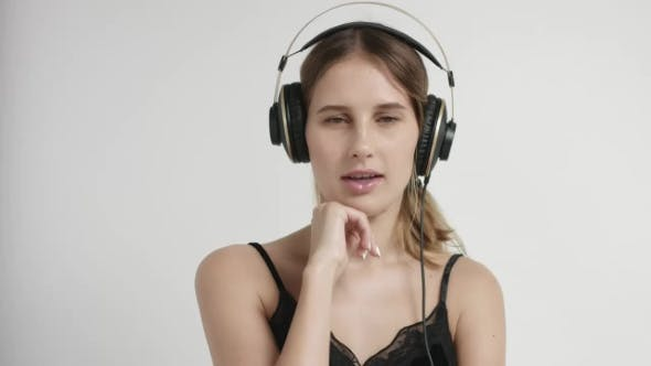 Thumbnail for Portrait of a Young Woman in Headphones
