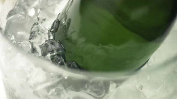 Thumbnail for Taking a Bottle of Sparkling Wine From Ice