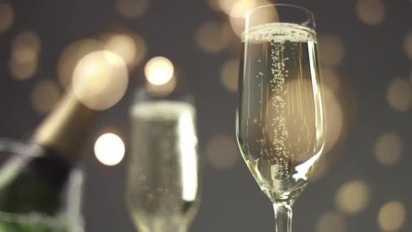 Cover Image for Festive Bubbles in a Glass of Sparkling Wine