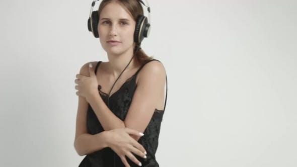Thumbnail for Cute Girl in Underwear Dancing To Music in Headphones