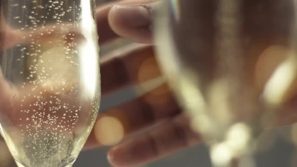 Thumbnail for Man Picking Up a Glass of Champagne with Bubbles