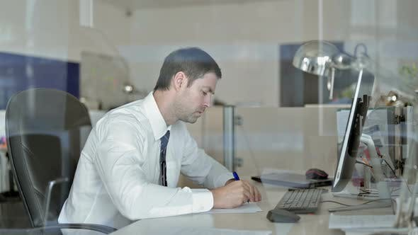 Thumbnail for Ambitious Middle Aged Businessman Writing Business Documents on Office Table