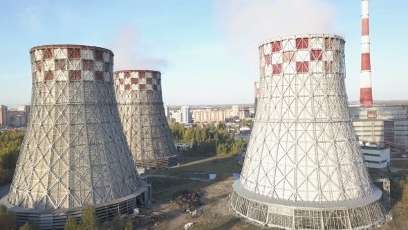 Thumbnail for Flying Over the Plant Producing Thermal Energy with Large Pipes. Aerial Shot