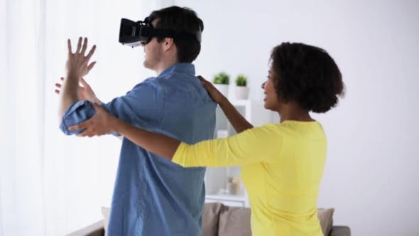 Happy Couple with Virtual Reality Headset at Home 48
