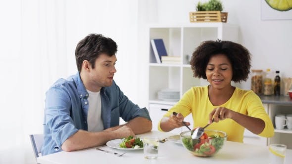 Thumbnail for Happy Couple Eating Vegetable Salad at Home 21