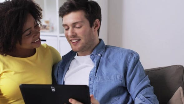 Thumbnail for Smiling Happy Couple with Tablet Pc at Home