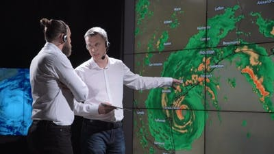 Scientists Tracking Hurricane on Map