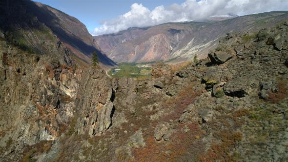 Thumbnail for Aerial Footage. Flying Over a Mountain Ridge and Valley. Rocky Terrain. Cliff
