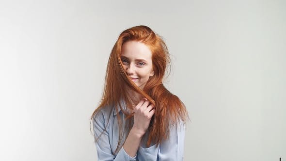 Thumbnail for Portrait of Pretty Redhead Girl Smiling Looking at Camera