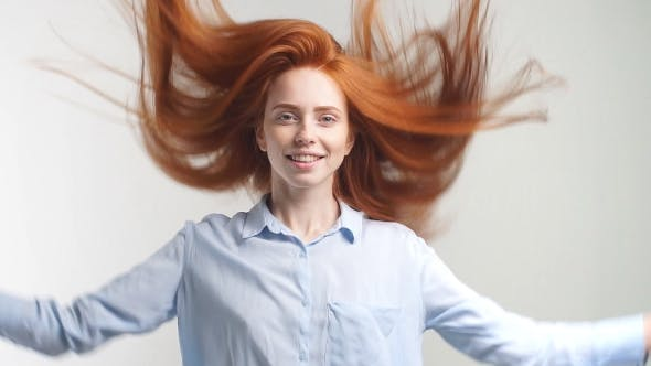 Thumbnail for Portrait of Beautiful Cheerful Redhead Girl with Flying Curly Hair Smiling Laughing Looking at
