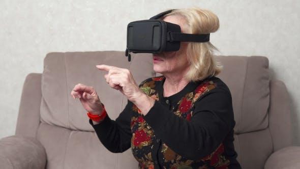 Thumbnail for Elderly Woman Using Vr Glasses