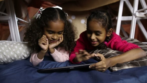 Cover Image for Smiling Little Girls Working on Digital Tablet