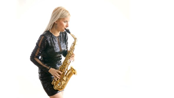 Beautiful Woman in Black Concert Dress Playing a Melody on Saxophone Melody Isolated Over White