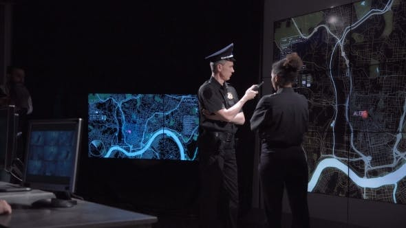 Thumbnail for Two Police Officers Watching a Digital Map