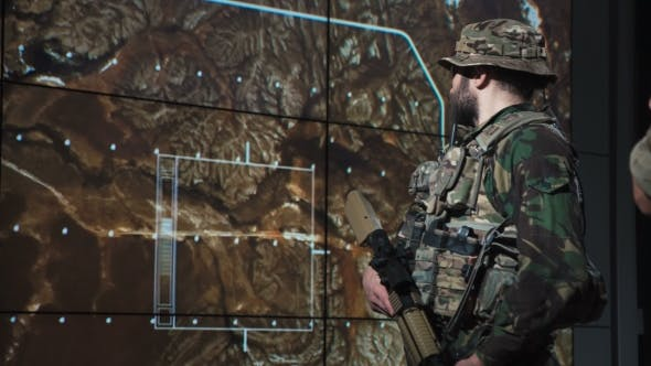 Thumbnail for Male Soldier Reviewing Monitor of Missle Launch