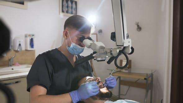 Thumbnail for Doctor Dentist Using Dental Microscope in Modern Dental Office for Operation. Male Dentist
