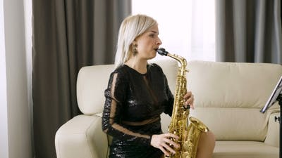 Jazz Saxophone Player Performing on the Sax in the Living Room