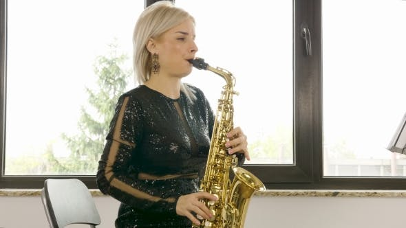 Thumbnail for Beautiful Saxophonist Woman Playing at the Sax in the Living Room