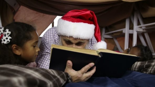 Thumbnail for Grandfather Reading a Book To His Granddaughters
