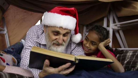 Thumbnail for Grandpa with Kids Reading Fairy Tales on Xmas Eve