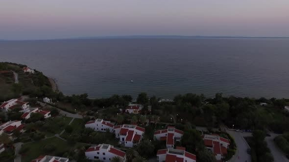 Thumbnail for Aerial Scene of Sea and Cottages on the Shore. Trikorfo Beach, Greece