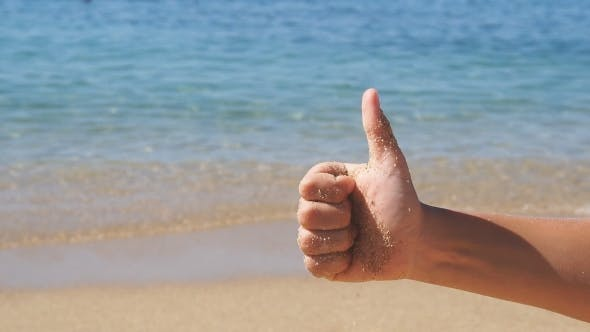 Thumbnail for Child Makes a Gesture of Thumbs Up on Background of Sea.