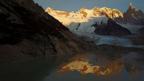 Flight Over Cerro Torre Mountain and Laguna Torre at Sunrise. Patagonia, Argentina