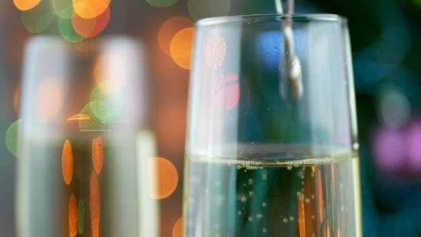 Thumbnail for Sparkling Wine Over Holiday Bokeh Blinking Background