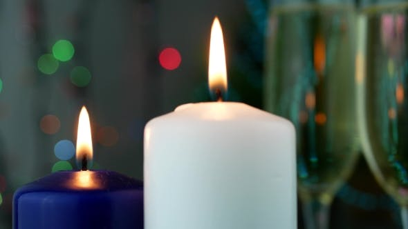 Thumbnail for Blue and White Wax Candles Burn