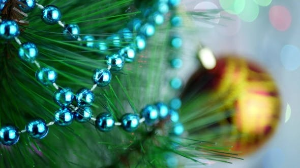 Thumbnail for Turquoise Decorative Garland on Christmas Tree with Blur Baubles