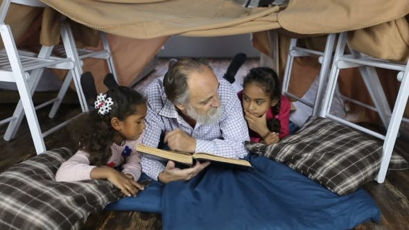 Thumbnail for Old Man Reading the Bible with Grandchildren