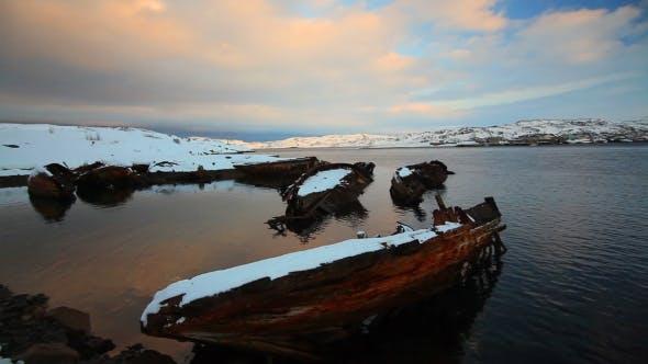 Cemetery of Small Fishing Boats in Teriberke at Sunrise. Murmansk Region, Russia. Full