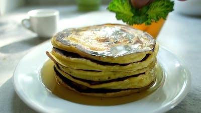 The Man Turns the Pancake