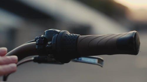 Female Hand Touching Handlebar Bike