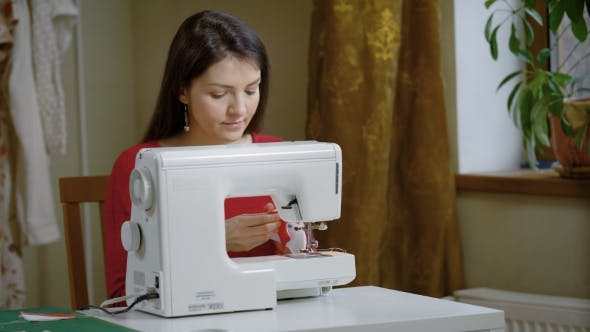 Thumbnail for A Woman Works for a Sewing Machine in a Home Studio, a Lady Makes Clothes, She Handles Creativity