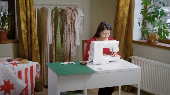 Thumbnail for A Woman Works for a Sewing Machine in Her Nebolshom Atelier, a Lady Makes Dresses, She Is a Designer