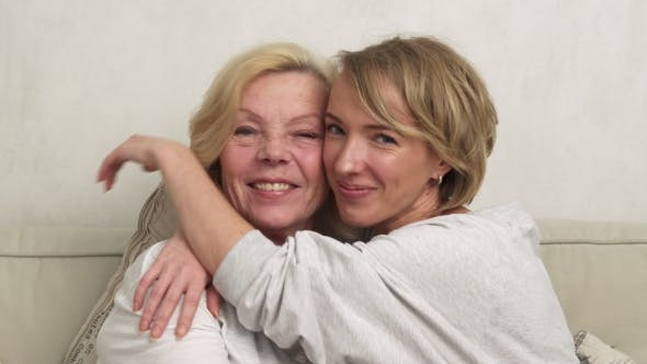 Thumbnail for Daughter and Mother Smiling and Embracing