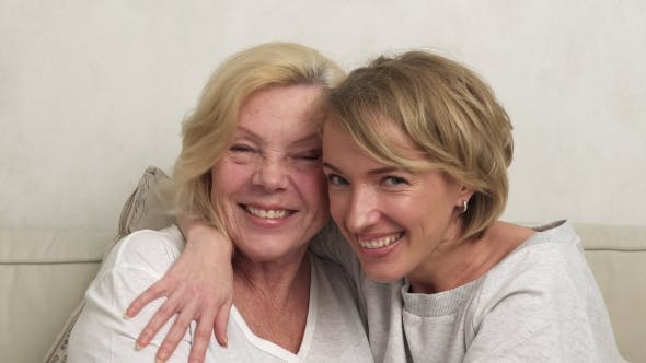 Happy Adult Daughter and Elderly Mother