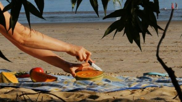 Picnic on a River Beach - Cutting Melon