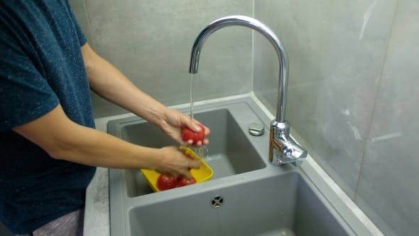 Thumbnail for Man Washes Tomatoes