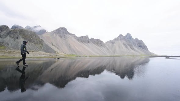 Cover Image for Tourist Near Famous Stokksnes Mountains
